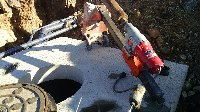 5 inch core drill hole in top of septic tanks Picture 1